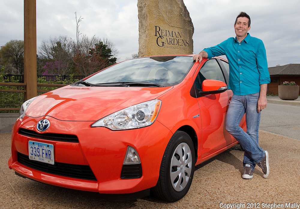Edward Moran of Ames with his new Toyota Prius C at Reiman Gardens on the campus of Iowa State University in Ames, Iowa on Thursday, March 29, 2012.