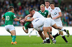 Matthew Byrne of Ireland U20 is tackled by Lewis Boyce of England U20 - Mandatory byline: Patrick Khachfe/JMP - 07966 386802 - 25/06/2016 - RUGBY UNION - AJ Bell Stadium - Manchester, England - England U20 v Ireland U20 - World Rugby U20 Championship Final 2016.