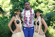 KO OLINA - FEBRUARY 11:  NFC Washington Redskins 2005 NFL Pro Bowl All-Stars Marcus Washington #53 poses with Hawaiian Hula girls for his 2005 NFL Pro Bowl team photo on February 11, 2005 in Ko Olina, Hawaii. ©Paul Anthony Spinelli