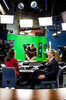Anchors Alycia Lane and Larry Mendte on the set of the CBS evening news broadcast in Philadelphia on Sept 28, 2006.