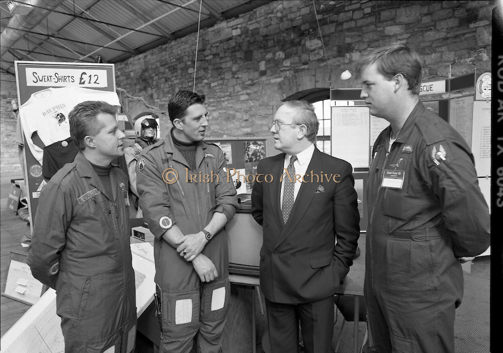 The 1989 Boat Show.   (R89)..1989..10.03.1989..03.10.1989..10th March 1989..Pat the Cope GallagherTD, Minister for the Marine attended the opening of the 1989 Boat Show held at the Point Depot, Dublin. The opening coincided with the minister's birthday...Image shows the Minister Pat the Cope Gallagher with members of the Air/Sea rescue team who took part in the Boat Show in the Point Depot.