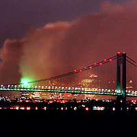 (PPAGE1) Port Monmouth 9/12/2001   A long exposure of the Manhattan Skyline as smoke covers the city where the world Trade Center towers once stood.    This photo taken from the Spy House Museum in Middletown Twp.   Michael J. Treola Staff Photographer....MJT