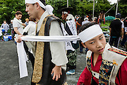 Minami-Soma, Fukushima prefecture, July 25 2015 - Local residents dressed in samurai are getting ready for the parade during Nomaoi festival.<br /> The Soma nomaoi is said to be a 1000-year-old traditional festival. It was held in 2011, a few months after the nuclear disaster, but only a few local horses were available.