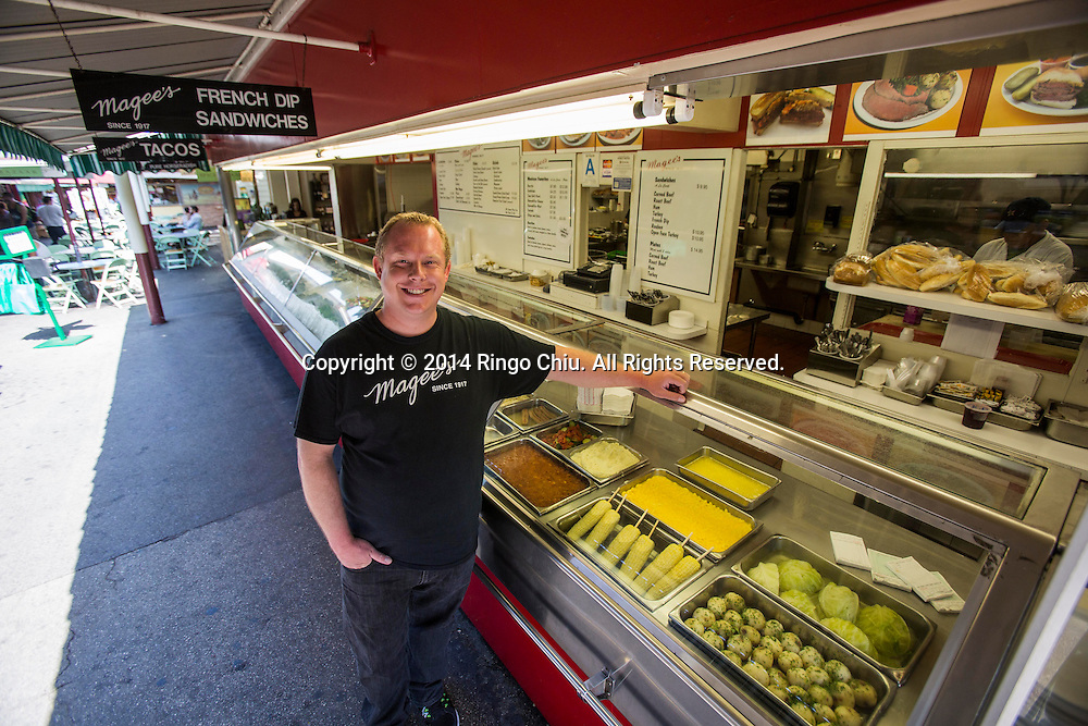 Dwayne Call, owner, Magee's Kitchen at Farmers Market. <br /> (Photo by Ringo Chiu/PHOTOFORMULA.com)