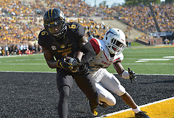Sep 24, 2016; Columbia, MO, USA; Missouri Tigers wide receiver J'Mon Moore (6) catches a pass for a touchdown as Delaware State Hornets defensive back Keyjuan Selby (20) during the first half at Faurot Field. Mandatory Credit: Denny Medley-USA TODAY Sports