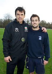 CARDIFF, WALES - Thursday, January 31, 2013: Wales' manager Chris Coleman with Sports Xtra Coach James Morris at the launch Vauxhall's Fun Football programme with the Football Association of Wales and the Welsh Football Trust at the Vale of Glamorgan Hotel. For more information please contact Amy White on 07805 936211.  (Pic by David Rawcliffe/Propaganda)