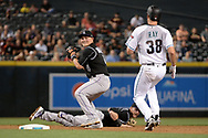 Apr 28, 2017; Phoenix, AZ, USA; Colorado Rockies infielder Pat Valaika (4) makes the out at second in front of Arizona Diamondbacks starting pitcher Robbie Ray (38) in the fifth inning at Chase Field. Mandatory Credit: Jennifer Stewart-USA TODAY Sports