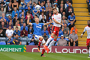 Crawley Town Defender, Alex Davey (5) beats Portsmouth Forward, Curtis Main (14) to the ball during the EFL Sky Bet League 2 match between Portsmouth and Crawley Town at Fratton Park, Portsmouth, England on 3 September 2016. Photo by Adam Rivers.