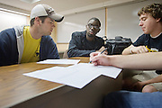 Senior engineering student Kegan Kavander, left, helps freshman engineering students Tolu Osunsanya, center, and Josh Palmer, and other team members discuss ethical problems On Friday, October 23, 2009 at the Stocker Center.