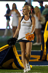 BERKELEY, CA - OCTOBER 06: A California Golden Bears cheerleader on the field before the game against the UCLA Bruins at California Memorial Stadium on October 6, 2012 in Berkeley, California. The California Golden Bears defeated the UCLA Bruins 43-17. (Photo by Jason O. Watson/Getty Images) *** Local Caption ***