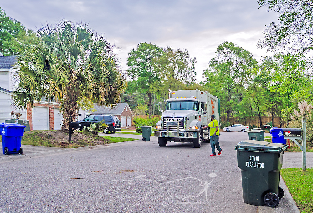 Carolina Waste employees empty trash in the Shadowmoss subdivision, April 7, 2015, in Charleston, S.C. Approximately 95 percent of the 60-truck fleet is comprised of Macks. The company was founded in 2002 and is the largest independently owned waste hauling company in the state. (Photo by Carmen K. Sisson/Cloudybright)