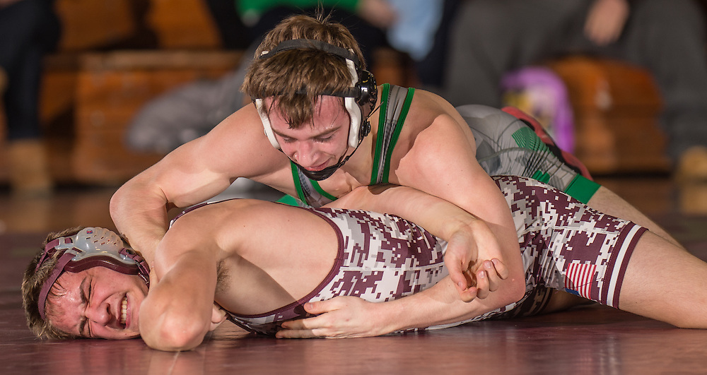Holy Cross' Cam Wasson battles Camden Catholic's Mark McCormick during the non-public B sectional wrestling finals at Holy Cross High School in Delran, NJ, Friday, February 13, 2015.  Photo by Bryan Woolston / @woolstonphoto.