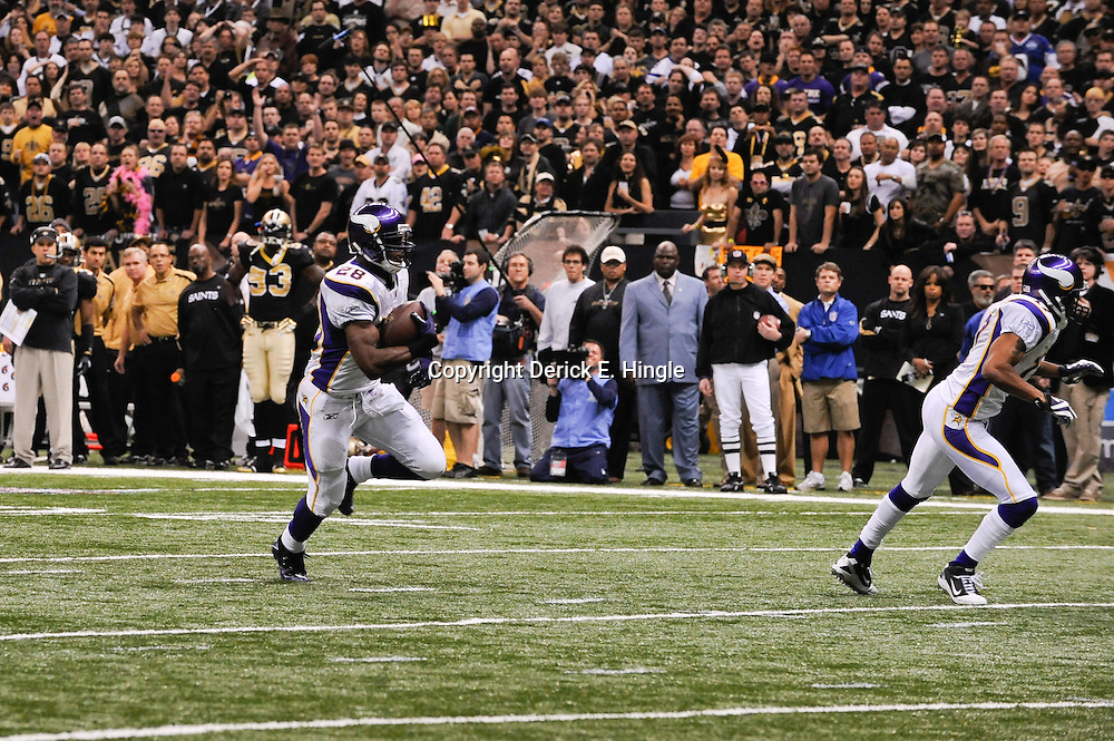 Jan 24, 2010; New Orleans, LA, USA; Minnesota Vikings running back Adrian Peterson (28) runs for a touchdown during a 31-28 overtime victory by the New Orleans Saints over the Minnesota Vikings in the 2010 NFC Championship game at the Louisiana Superdome. Mandatory Credit: Derick E. Hingle-US PRESSWIRE
