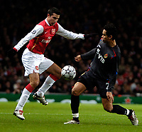 Photo: Ed Godden.<br /> Arsenal v CSKA Moscow. UEFA Champions League, Group G. 01/11/2006. Arsenal's Robin Van Persie (L) is challenged by Dudu.
