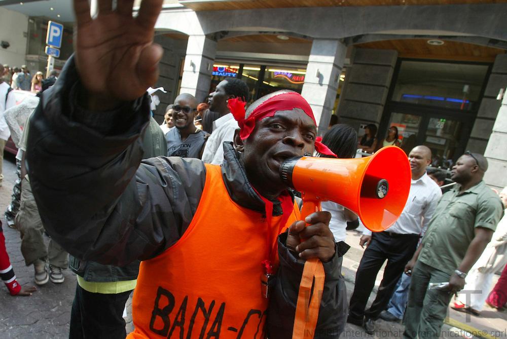 BRUSSELS - BELGIUM - 30 JUNE 2006  -- Matonge the African City in the City at Porte De Namur --Peacefull demontrator with his megaphone.  PHOTO: ERIK LUNTANG /