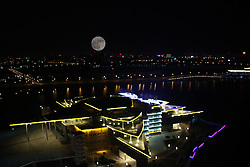 November 14, 2016 - Binzhou, Binzhou, China - Binzhou,CHINA-November 14 2016: (EDITORIAL USE ONLY. CHINA OUT)..The supermoon shines over the sky in Binzhou, east China's Shandong Province, November 14th, 2016 (double exposure). According to the Irish Astronomical Association, the full moon's relative proximity should make it appear about 14 percent bigger and 30 percent brighter than at its furthest orbit point. (Credit Image: © SIPA Asia via ZUMA Wire)