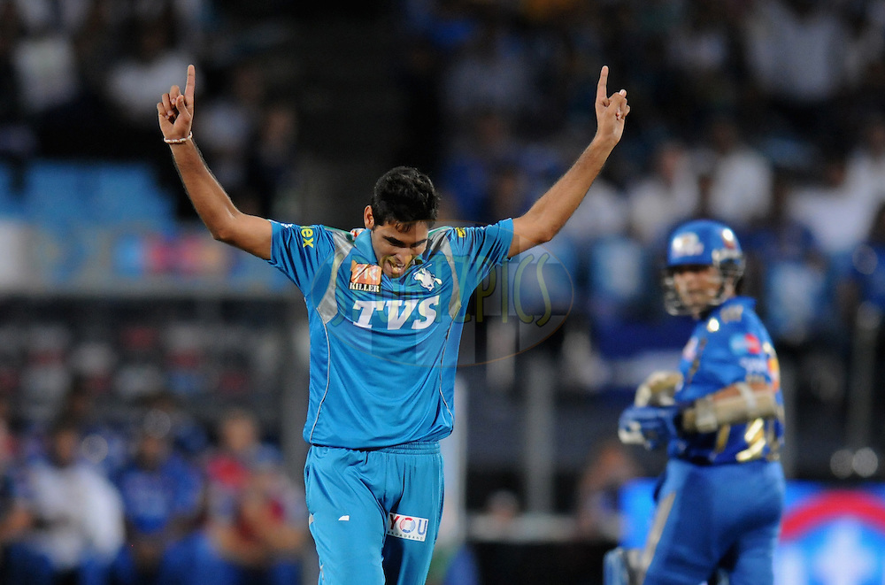 Bhuvneshwar Kumar of Pune Warriors India celebrate the wicket of James Franklin of Mumbai Indians during match 45 of the Indian Premier League ( IPL) 2012  between The Pune Warriors India and the Mumbai Indians held at the Subrata Roy Sahara Stadium, Pune on the 3rd May 2012..Photo by Pal Pillai/IPL/SPORTZPICS