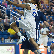 11/11/11 Newark DE: Junior Guard #21 Trumae Lucas drives to the basket during a week one NCAA Women's College basketball game, Friday, Nov. 11, 2011 at the Bob carpenter center in Newark Delaware.<br /> <br /> Delaware would go on to defeat the Rhode Island rams 89-53.<br /> <br /> Special to The News Journal/SAQUAN STIMPSON