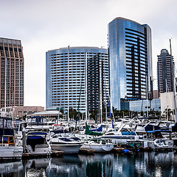 San Diego skyline with Embarcadero Marina luxury yachts and downtown city buildings on the water
