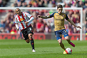 Arsenal defender Hector Bellerin (24) in action chased by Sunderland's Midfielder Wahbi Khazri (22) during the Barclays Premier League match between Sunderland and Arsenal at the Stadium Of Light, Sunderland, England on 24 April 2016. Photo by George Ledger.