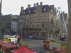 © Licensed to London News Pictures. 17/04/2015. Oxford, UK Firefighters have been battling the flames at The Randolph on Beaumont Street since about 16:30 BST. The street has been closed both ways to allow emergency services access to the building.<br /> Eyewitnesses have reported thick black smoke plumes coming from the vicinity of the Victorian gothic building.. Photo credit : LNP