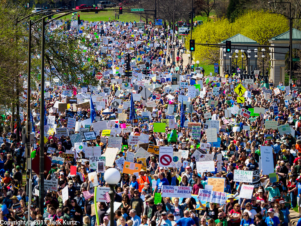 22 APRIL 2017 - ST. PAUL, MN: Marchers make their way to the Minnesota State Capitol during the March for Science. More than 10,000 people marched from the St. Paul Cathedral to the Minnesota State Capitol in St. Paul during the March for Science. March organizers said the march was non-partisan and was to show support for the sciences, including the sciences behind climate change and vaccines.      PHOTO BY JACK KURTZ
