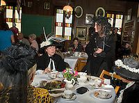 Judy Cott, Dee Chitty (standing), Dot Chitty and Sandy Perry enjoy an afternoon tea and luncheon dressed in 1800's fashion at the Union Meetinghouse with the Thompson Ames Historical Society Saturday afternoon.  (Karen Bobotas/for the Laconia Daily Sun)