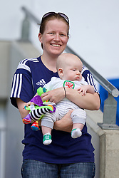 CARDIFF, WALES - Friday, June 5, 2015: Wales' performance analyst Esther Laugharne and baby Iolo during a practice match at the Cardiff City Stadium ahead of the UEFA Euro 2016 Qualifying Round Group B match against Belgium. (Pic by David Rawcliffe/Propaganda)