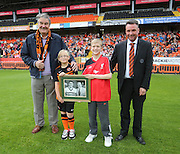 Youngsters Alisha Davidson and Jack Hutchison along with United associate director Colin Stewart presented a photo to United and Liverpool legend Ron Yeats - Dundee United open day at Tannadice<br /> <br /> <br />  - &copy; David Young - www.davidyoungphoto.co.uk - email: davidyoungphoto@gmail.com