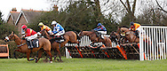 Leighton Aspell (Red Silks) riding McKenzie's Friend clears an early hurdle before winning the J H Builders National Hunt Novices Hurdle at Plumpton Racecourse - 13 Dec 2015