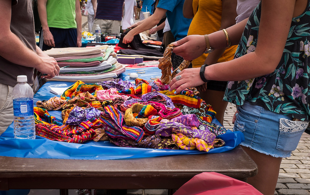Patrons inspect hand-dyed headbands during the International Street Fair on Saturday, April 18, 2015.  Photo by Ohio University  /  Rob Hardin