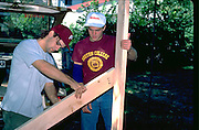 Macalester College roommates age 18 building loft for dorm.   St Paul Minnesota USA