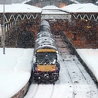 6.12.2010. A train waits at its white platform at Perth Railway Station.<br /> COPYRIGHT: Perthshire Picture Agency.<br /> Tel. 01738 623350 / 07775 852112.