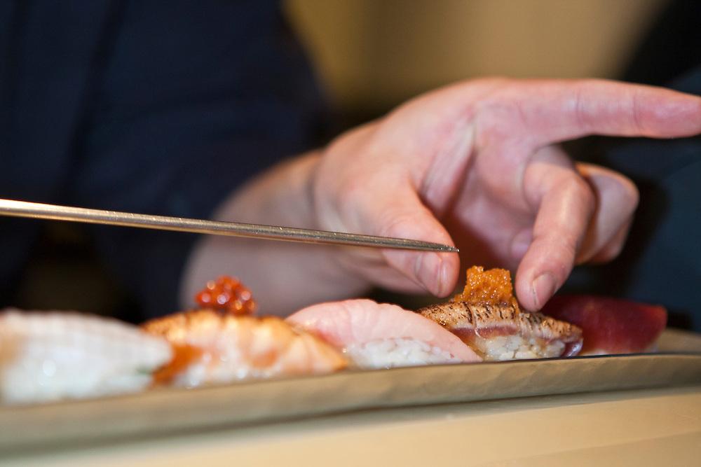 Chef Noriaki Yasutake uses chopsticks to place the roe just so.
