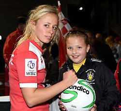 Nadia Lawrence of Bristol Academy Women autographs a young fan's ball - Mandatory by-line: Paul Knight/JMP - Mobile: 07966 386802 - 04/10/2015 -  FOOTBALL - Stoke Gifford Stadium - Bristol, England -  Bristol Academy Women v Liverpool Ladies FC - FA Women's Super League