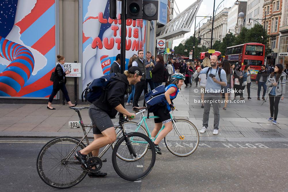 Street photographer, Matt Stuart in Oxford Street.