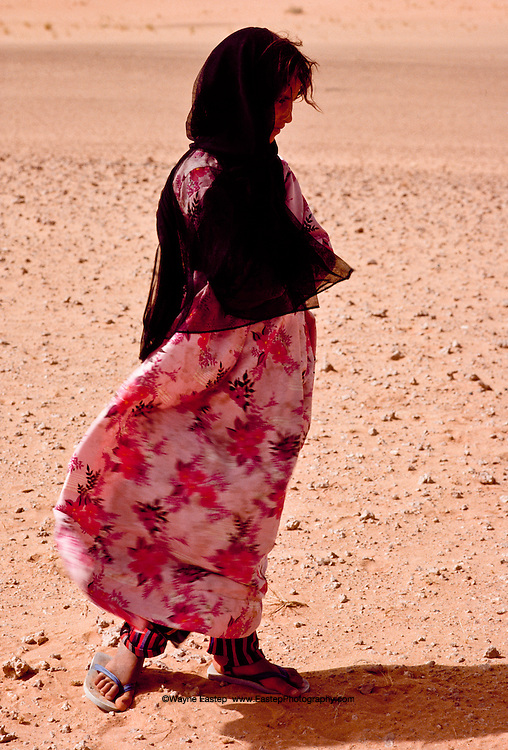 Portrait of Hulla Greeyet, of the Shammar tribe, herding sheep in the Nafud Desert.