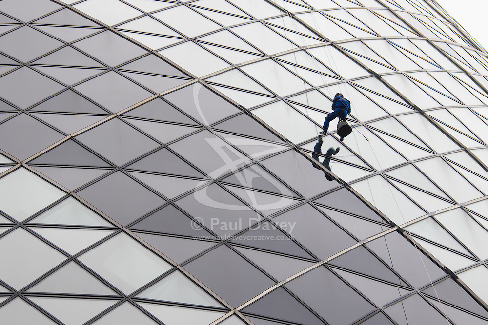 London, September 7th 2015. PICTURED: The Gerkhin's property Manager Jimmy Demetriou abseils down the face of the building he manages.  The Outward Bound Trust City Three Peaks Challenge in conjunction with The Royal Navy and Royal Marines Charity is a breathtaking abseiling endeavour on the greatest urban mountain range: The City of London.