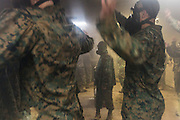 US Marine recruits inside the gas chamber during bootcamp January 13, 2014 in Parris Island, SC.