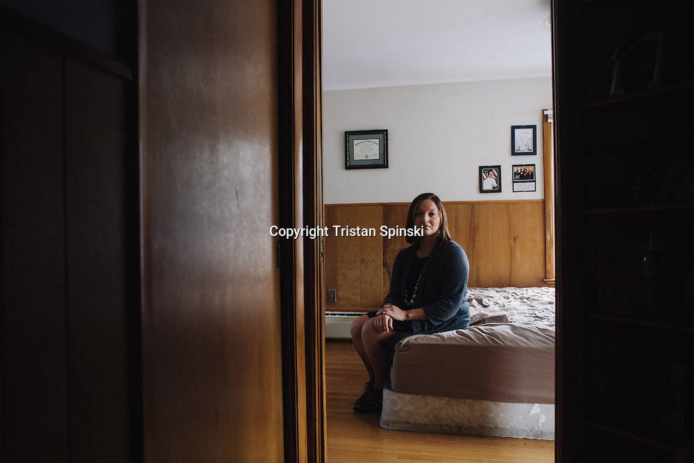 Tiffany Martinez, 26, of Portland, Maine, stands for a portrait in her brother's home in Portland, Maine, on Saturday, Sept. 13, 2014. Martinez, now a Family Psychiatric Mental Health Nurse Practitioner, began exhibiting symptoms of schizophrenia, a condition her father suffers from, several years ago. She no longer takes anti-psychotic medications and is symptom free, which she credits to therapy, stress reduction, exercises in mindfulness, physical activity, and changes in diet.