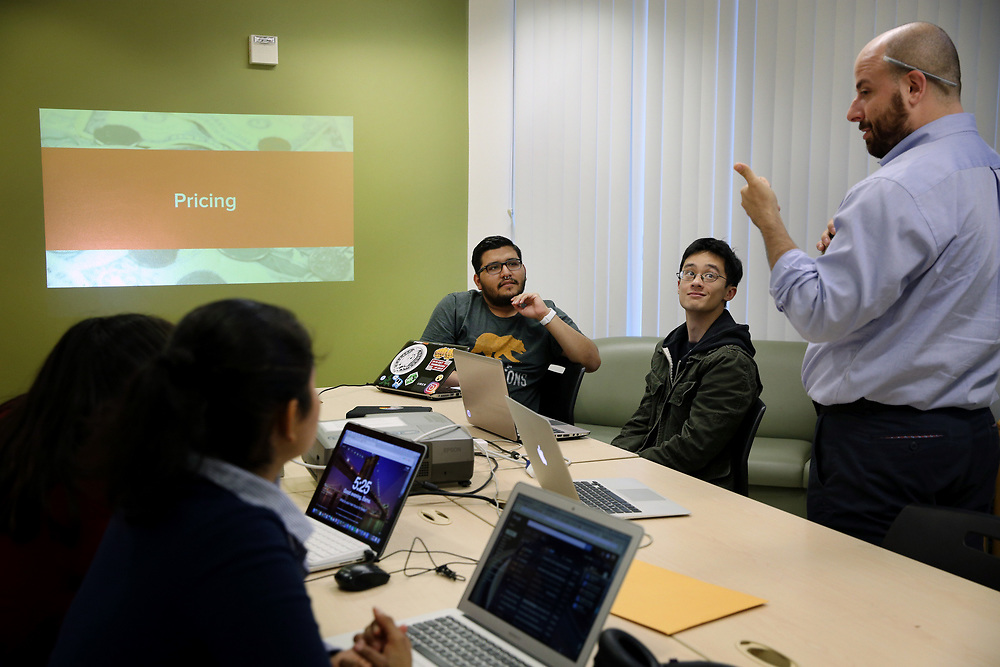 From right: Caleb Jonas instructs Anthony Khieu and Noé Ramon on Thursday, Nov. 2, 2017, in San Francisco, Calif. The nonprofit Samaschool is helping job seekers learn about gig economy work.