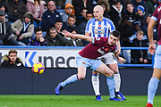 Aaron Mooy of Huddersfield Town (10) and Declan Rice of West Ham United (41) wrestle for the ball during the Premier League match between Huddersfield Town and West Ham United at the John Smiths Stadium, Huddersfield, England on 10 November 2018.