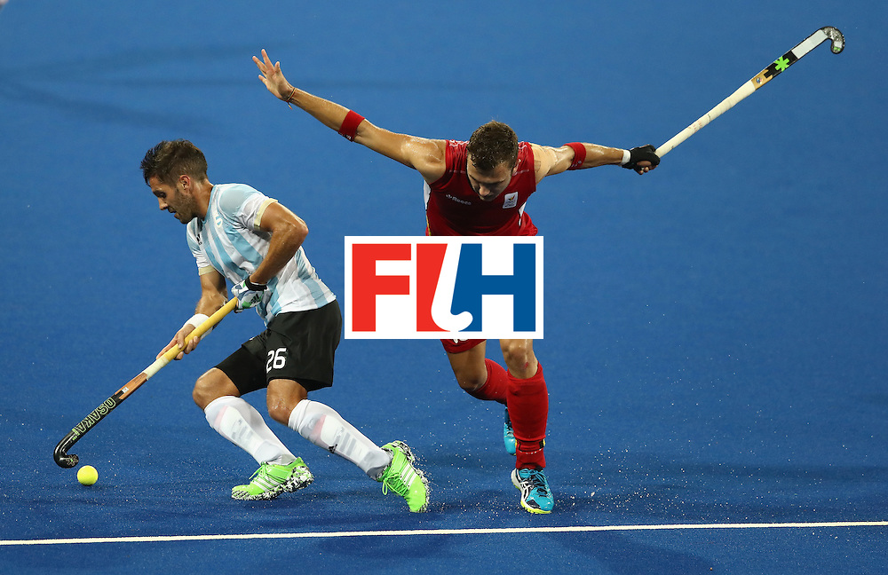 RIO DE JANEIRO, BRAZIL - AUGUST 18:  Agustin Mazzilli (L) of Argentina is tackled by Emmanuel Stockbroekx during the Men's Gold Medal match between Argentina and Belgium on Day 13 of the Rio 2016 Olympic Games held at the Olympic Hockey Centre on August 18, 2016 in Rio de Janeiro, Brazil.  (Photo by David Rogers/Getty Images)