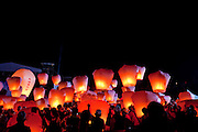 Pingxi Sky Lantern Festival, Pingxi, Taiwan. Sky lanterns are airborne paper lanterns traditionally found in some Asian cultures. They are constructed from oiled rice paper on a bamboo frame, and contain a small candle or fuel cell composed of a waxy flammable material. When lit, the flame heats the air inside the lantern, thus lowering its density causing the lantern to rise into the air. The sky lantern is only airborne for as long as the flame stays alight, after which the lantern floats back to the ground.