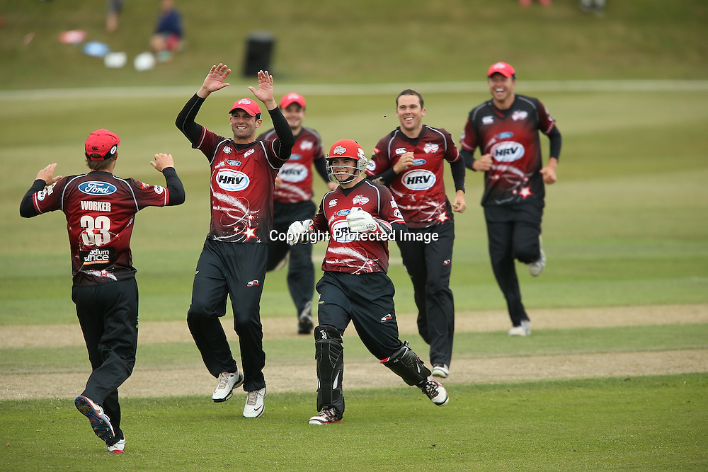 Canterbury team mates celebrate during the HRV Cup Twenty20 Cricket match between Canterbury Wizards and Otago Volts at Aorangi Oval, Timaru on Thursday 27 December 2012. Photo: Martin Hunter/Photosport.co.nz