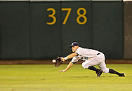 Kernels center fielder Andy Workman (28) makes a diving catch during the fourth inning of the game between the Beloit Snappers and the Cedar Rapids Kernels at Veterans Memorial Stadium in Cedar Rapids on Saturday evening, August 25, 2012.