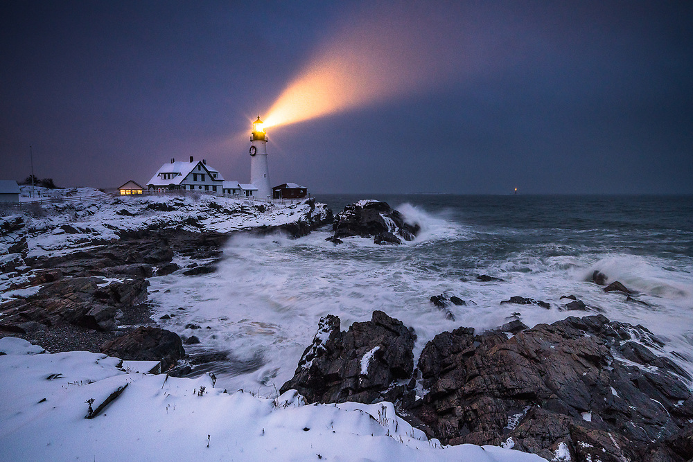 Waves batter the shoreline at one of Maine's most iconic locations, Portland Head Light. I had wanted to get an image of this place at night during a snow storm for a long time. The snow in the air caught the light of the beam, making it visible in this exposure.