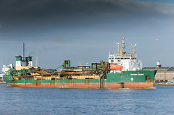 The suction dredger, Britannia Beaver steams downriver on the River Thames.