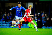 Portsmouth's Marc McNulty and Accrington Stanley's Bradley Halliday during the The FA Cup match between Portsmouth and Accrington Stanley at Fratton Park, Portsmouth, England on 5 December 2015. Photo by Graham Hunt.