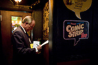 8 October, 2008. New York, NY. Harry Hurt III, columnist of Executive Pursuits for The New York Times,  takes notes and learns how to become a stand-comic at the Comic Strip club in Manhattan, NY.  He trained minutes before with the comic and m.c. D.F. Sweedler.  He will then go on stage in front of a live audience.  <br /> <br /> &copy;2008 Gianni Cipriano for The New York Times<br /> cell. +1 646 465 2168 (USA)<br /> cell. +1 328 567 7923 (Italy)<br /> gianni@giannicipriano.com<br /> www.giannicipriano.com